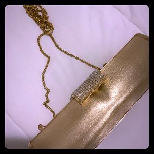 Women's gold clutch / used once / with gold handle